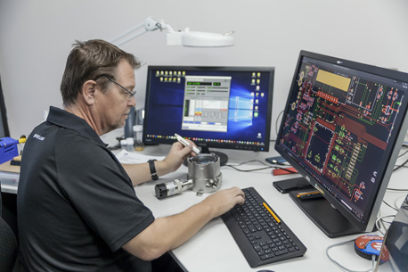 man at desk analysing gas detec tor schematic